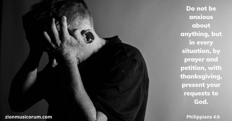 man wearing black having stress